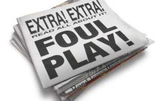 "A newspaper with the words ""Foul Play."""