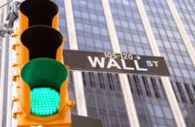 Green traffic light on Wall Street in New York City