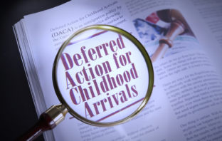 Deferred Action for Childhood Arrivals words under a magnifying glass