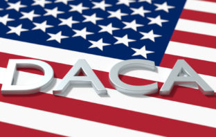 The word DACA on top of United States Flag