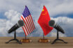 United States and China flag with two microphones