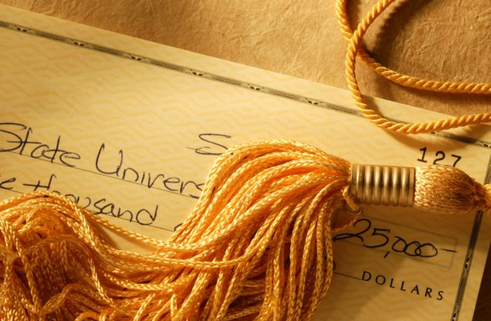 Gold tassel on a check written for college tuition