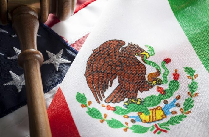 United States and Mexico flags with gavel